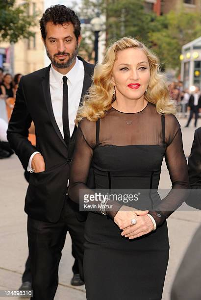 Manager Guy Oseary and director Madonna arrive at WE Premiere at TIFF Bell Lightbox during the 2011 Toronto International Film Festival on September...