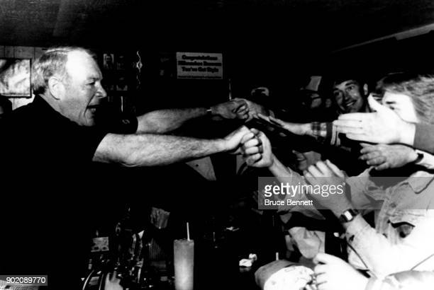 Manager Harvey Kuenn of the Milwaukee Brewers is mobbed by fans at Harvey's Bar after the 1982 World Series Game 4 against the St Louis Cardinals on...