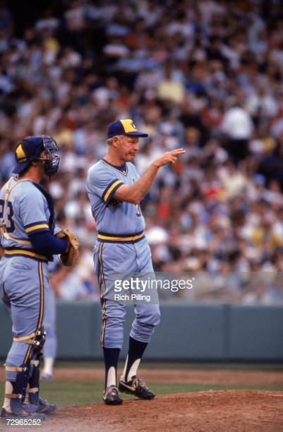 Manager Harvey Kuenn of the Milwaukee Brewers signals to the bullpen as he stands on the mound during a game circa 19821983 Harvey Kuenn managed the...