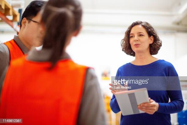 manager having meeting with warehouse employees - german short haired pointer stock pictures, royalty-free photos & images