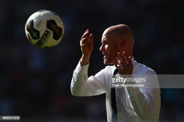Manager / Head Coach of FC Utrecht Erik ten Hag throws the ball to a player during the Dutch Eredivisie match between FC Utrecht and FC Twente at...