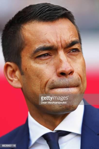 Manager / Head Coach of Feyenoord Rotterdam Giovanni van Bronckhorst looks on prior to the Dutch Eredivisie match between Ajax Amsterdam and...