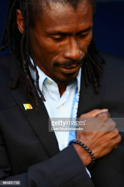 Manager / Head Coach of Senegal Aliou Cisse puts his hand to his heart after the national anthem prior to the 2018 FIFA World Cup Russia group H...