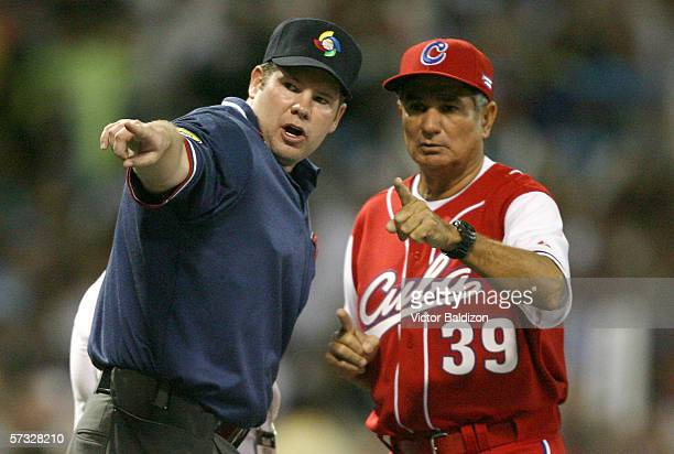 Manager Higinio Velez of Cuba speaks with an umpire during the game against Puerto Rico on March 15 2006 at Hiram Bithorn Stadium in San Juan Puerto...
