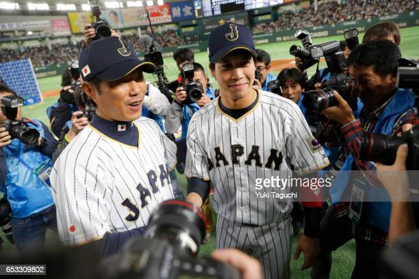 Manager Hiroki Kokubo and Tetsuto Yamada of Team Japan shake hands after Team Japan defeated Team Cuba in Game 4 of Pool E of the 2017 World Baseball...