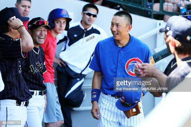 Manager Hiroki Kokubo of Japan and Munenori Kawasaki of Chicago Cubsin speke on during the exhibition game between Japan and Chicago Cubs at Sloan...