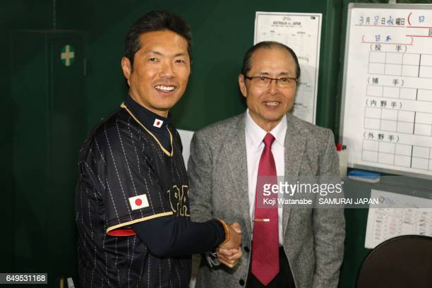 Manager Hiroki Kokubo of Japan shakes hands with former manager Sadaharu Oh after the World Baseball Classic Pool B Game Three between Japan and...