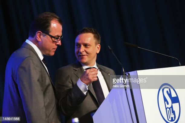 Manager Horst Heldt and CEO Clemens Toennies chat during the annual meeting of FC Schalke 04 at Emscher Lippe Halle on June 3, 2012 in Gelsenkirchen,...