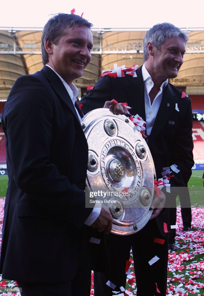Manager Horst Heldt (L) and coach Armin Veh of VfB Stuttgart pose with the trophy after winning the German championships after the Bundesliga match against Energie Cottbus at the Gottlieb-Daimler stadium on May 19, 2007 in Stuttgart, Germany.
