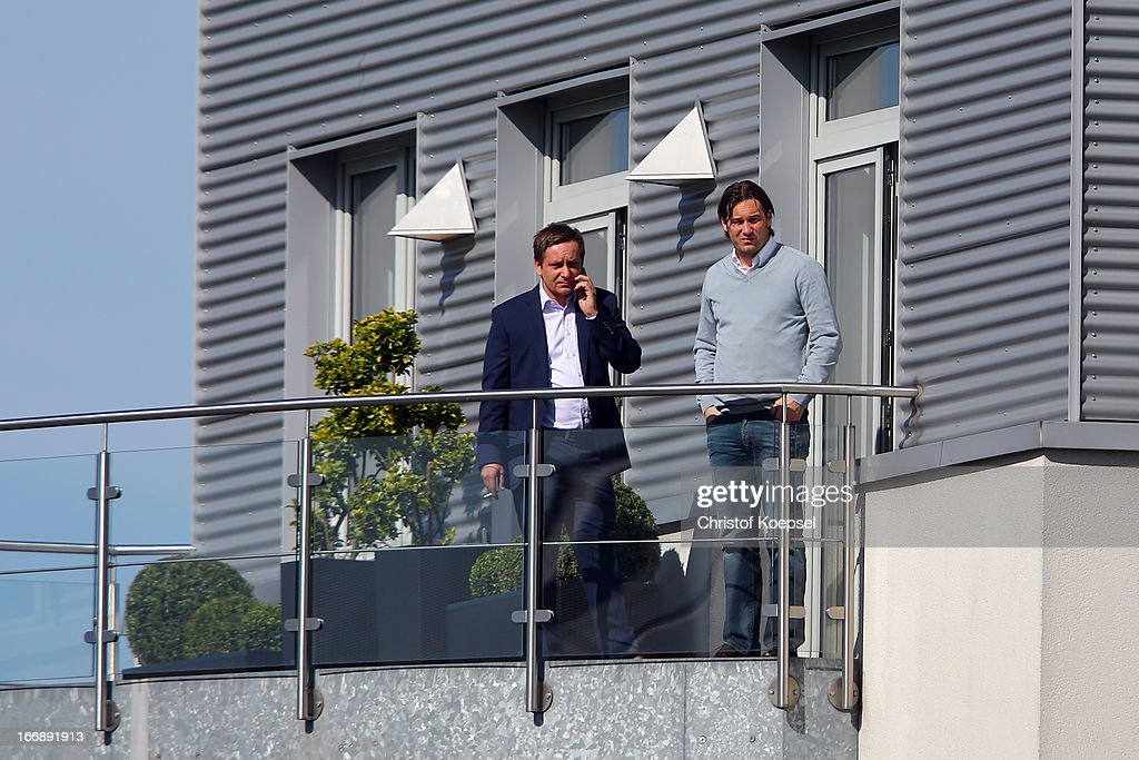 Manager Horst Heldt and director Gerhard Zuber stand on the balcony to watch the FC Schalke 04 training session at their training ground on April 18, 2013 in Gelsenkirchen, Germany.