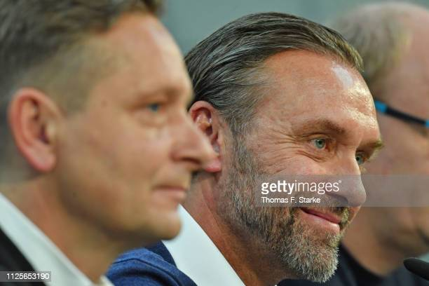 Manager Horst Heldt and new head coach Thomas Doll speak at the press conference prior to the Hannover 96 training session at the training ground...
