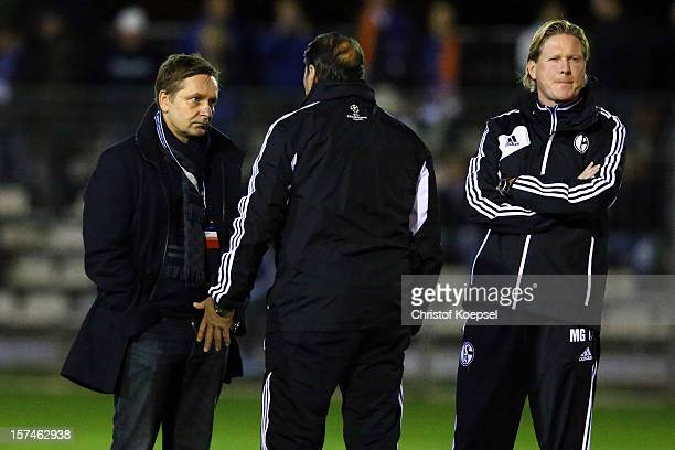 Manager Horst Heldt head coach Huub Stevens and assistant coach Markus Gisdol talk during the training session of FC Schalke 04 at training ground of...