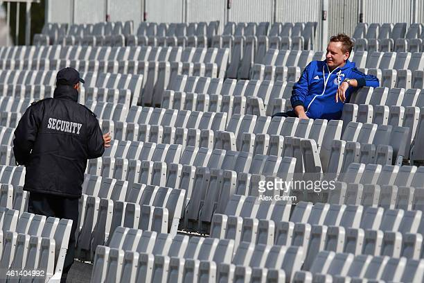 Manager Horst Heldt is asked to leave the stand during day 7 of the FC Schalke 04 training camp at the ASPIRE Academy for Sports Excellence on...