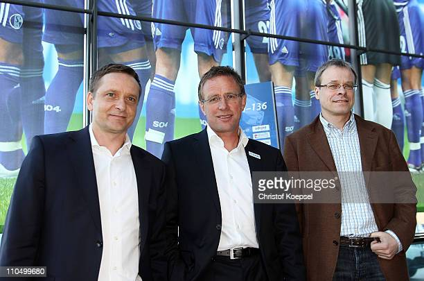 Manager Horst Heldt, new head coach Ralf Rangnick and member of the board, Peter Peters, pose prior to a press conference at the Veltins Arena on...