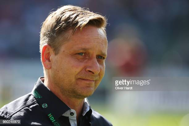 Manager Horst Heldt of Hannover looks on prior to the Bundesliga match between Hannover 96 and FC Bayern Muenchen at HDIArena on April 21 2018 in...