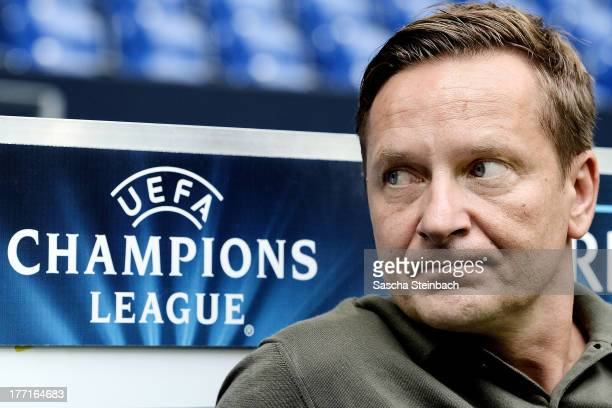 Manager Horst Heldt of Schalke looks on during a FC Schalke 04 training session prior to their UEFA Champions League qualification match against POAK...