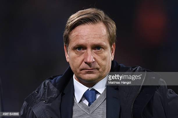 Manager Horst Heldt of Schalke looks on prior to the Bundesliga match between FC Schalke 04 and FC Bayern Muenchen at VeltinsArena on November 21...