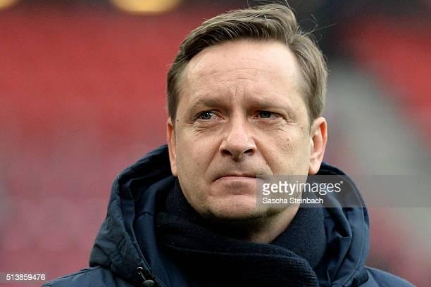 Manager Horst Heldt of Schalke looks on prior to the Bundesliga match between 1 FC Koeln and FC Schalke 04 at RheinEnergieStadion on March 5 2016 in...