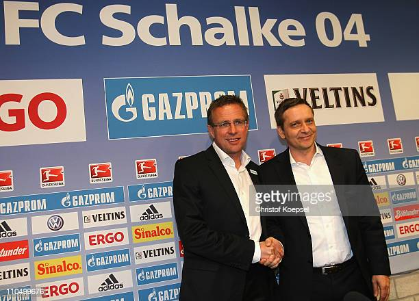 Manager Horst heldt of Schalke welcomes new head coach Ralf Rangnick during a press conference at the Veltins Arena on March 21, 2011 in...