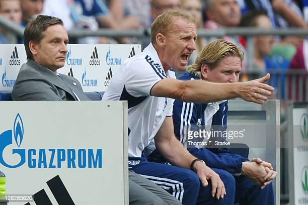 Manager Horst Heldt provisional coach Josef Seppo Eichkorn and assistant coach Markus Gisdol reacts during the Bundesliga match between FC Schalke 04...