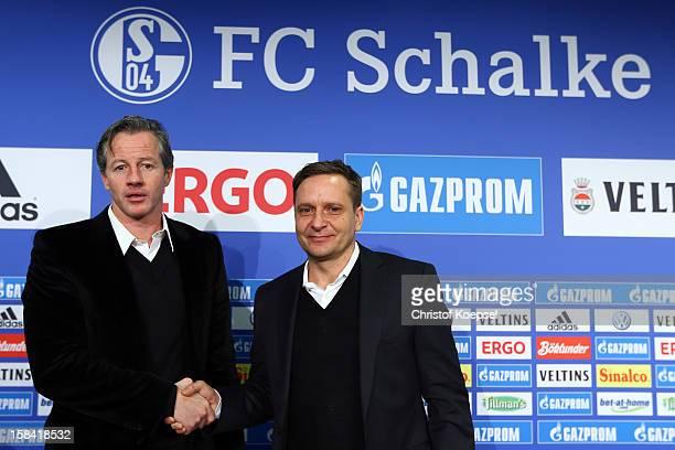 Manager Horst Heldt shake hands with new head coach Jens Keller during a FC Schalke 04 press conference at VeltinsArena on December 16 2012 in...