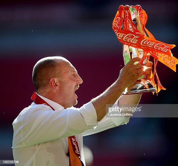 Manager Ian Holloway of Blackpool celebrates promotion to the Premier League during the CocaCola Championship Playoff Final between Blackpool and...