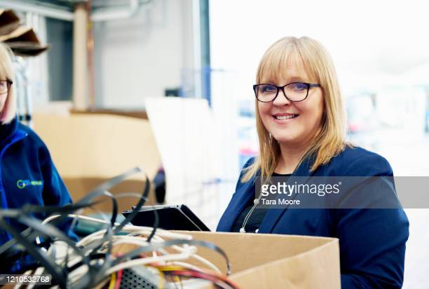 manager in computer parts warehouse - femalefocuscollection stock pictures, royalty-free photos & images