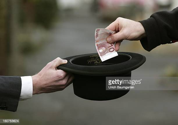 GERMANY BONN Manager is begging with his bowler hat icon for the financial and the banking crisis