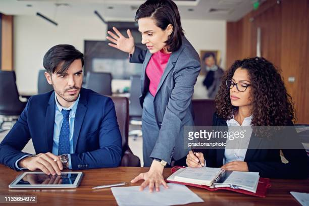 manager is shouting to employee after his mistake in the ceo office - bossy stock pictures, royalty-free photos & images