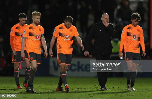 Manager Jaap Stam of Reading and his players look dejected as they leave the field during The Emirates FA Cup Third Round match between Stevenage and...