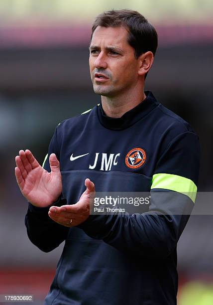 Manager Jackie McNamara of Dundee United claps during the Scottish Premier League match between Dundee United and Inverness Caledonian Thistle at...