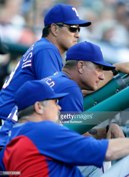 Manager Jeff Banister of the Texas Rangers center watches the game against the Detroit Tigers with bench coach Don Wakamatsu of the Texas Rangers top...