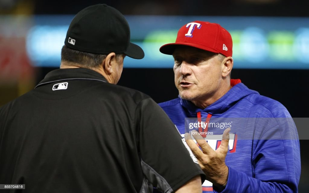 Manager Jeff Banister #28 of the Texas Rangers has a discussion with first base umpire Tony Randazzo #11 during the third inning at Globe Life Park in Arlington on September 29, 2017 in Arlington, Texas.