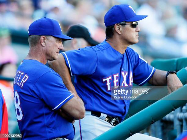 Manager Jeff Banister of the Texas Rangers watches the game against the Detroit Tigers with bench coach Don Wakamatsu of the Texas Rangers at...