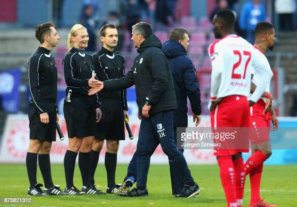 Manager Jens Haertel of Magdeburg shakes hands with referee Bibiana Steinhaus after the 3 Liga match between SC Fortuna Koeln and 1 FC Magdeburg at...