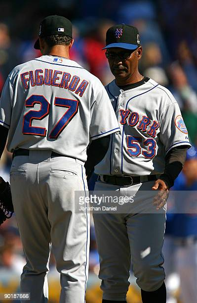 Manager Jerry Manuel of the New York Mets removes starting pitcher Nelson Figueroa from a game against the Chicago Cubs on August 30 2009 at Wrigley...