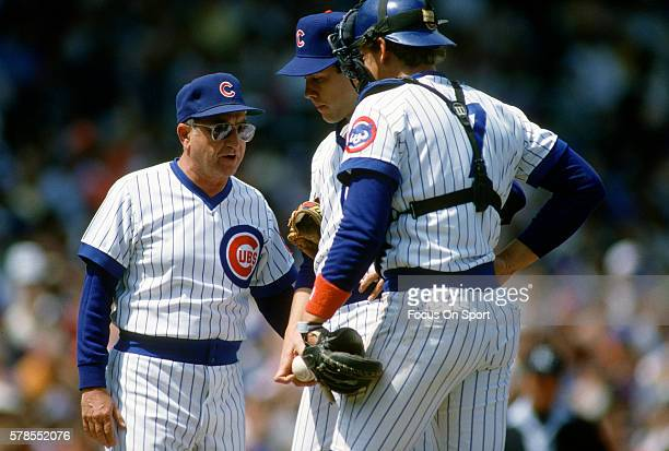 Manager Jim Frey of the Chicago Cubs comes to the mound to talk with pitcher Larry Sorensen during a Major League Baseball game circa 1985 at Wrigley...