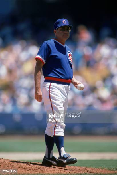 Manager Jim Frey of the Chicago Cubs stands on the mound with a ball as he waits for a relief pitcher during a game against the Los Angeles Dodgers...