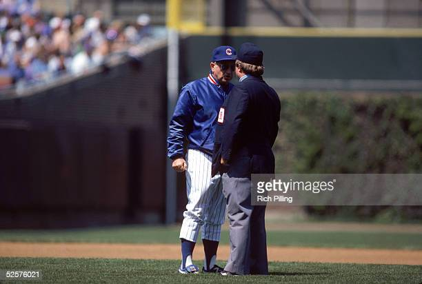 Manager Jim Frey of the Chicago Cubs talks with an umpire on the field during a game in may of 1985 at Wrigley Field in Chicago Illinois