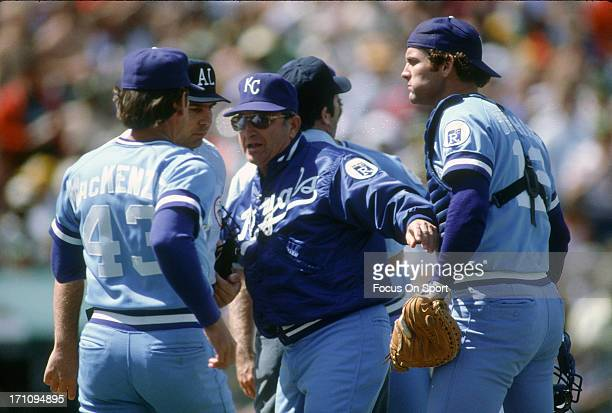 Manager Jim Frey of the Kansas City Royals separates his catcher John Wathan from an umpire during a Major League Baseball game against the New York...