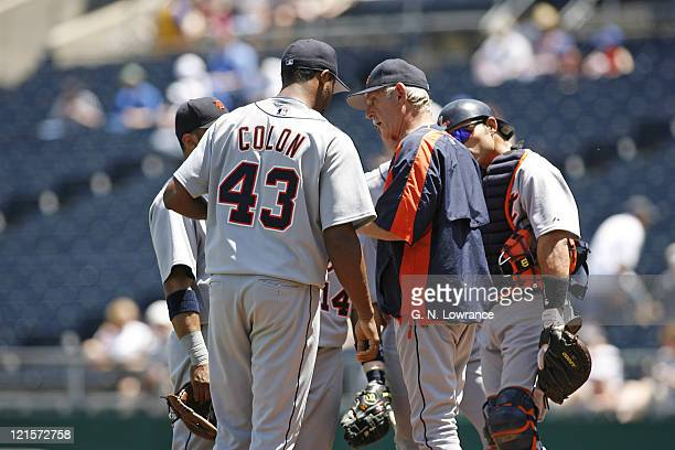 Manager Jim Leyland hands the ball to reliever Roman Colon during action between the Detroit Tigers and Kansas City Royals at Kauffman Stadium in...