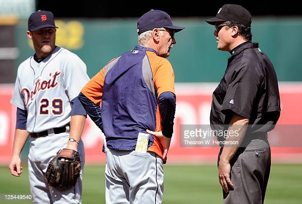 Manager Jim Leyland of the Detroit Tigers argues with first base umpire Mike DiMuro over a call at first base as Danny Worth looks on against the...