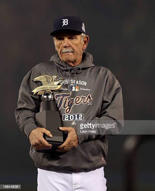Manager Jim Leyland of the Detroit Tigers holds the American League Championship trophy after they won 81 against the New York Yankees during game...