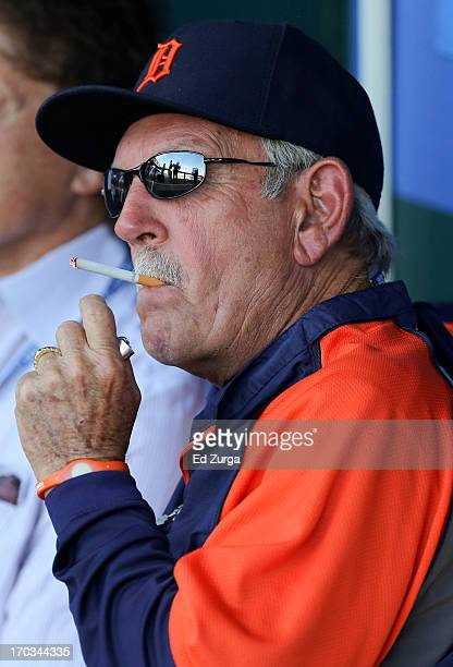 Manager Jim Leyland of the Detroit Tigers puffs on a cigarette in the dugout during batting practice prior to a game against the Kansas City Royals...