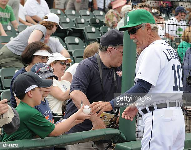Manager Jim Leyland of the Detroit Tigers signs autographs while wearing a green hat for St. Patricks Day before the spring training game against the...