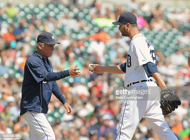 Manager Jim Leyland of the Detroit Tigers takes the baseball from Armando Galarraga during the game against the Kansas City Royals at Comerica Park...