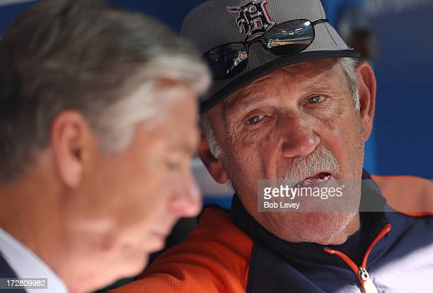 Manager Jim Leyland of the Detroit Tigers talks to general manager Dave Dombrowski before MLB game action against the Toronto Blue Jays on July 4...