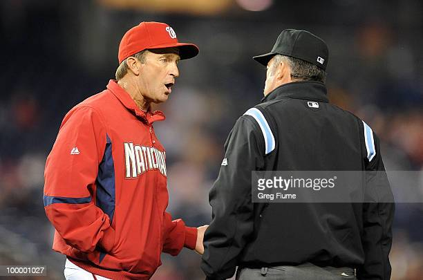 Manager Jim Riggleman of the Washington Nationals argues with first base umpire Tim Tschida after the New York Mets turned a triple play in the fifth...