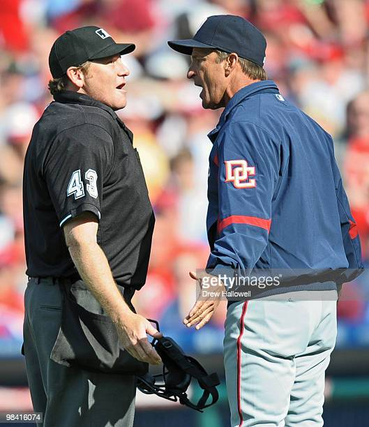 Manager Jim Riggleman of the Washington Nationals argues with home plate umpire Paul Schrieber after getting ejected during the game against the...