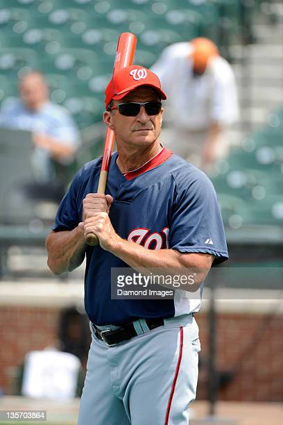 Manager Jim Riggleman of the Washington Nationals looks towards the seats as he hits fungoes prior to a game on June 26 2010 against the Baltimore...